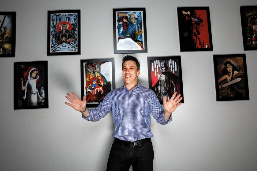 Fandango President Paul Yanover in front of fan art curated by the Los Angeles company to create moviegoing buzz.