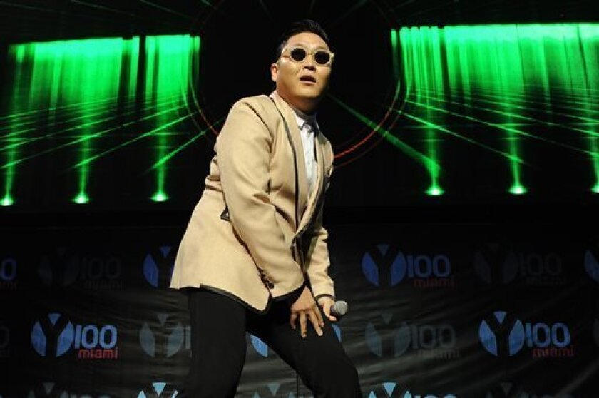 """FILE - This Dec. 8, 2012 file photo shows South Korean pop star PSY during the Y100's Jingle Ball 2012 at the BB&T Center in Ft Lauderdale, Fla. PSY's first new single since his viral hit """"Gangnam Style"""" is stealing attention from inter-Korean tensions. YG Entertainment, PSY's agency, says """"Gentleman"""" was released in 119 countries on Friday, April 12, 2013. PSY co-composed the electronic dance music and wrote the lyrics for the song, which pokes fun at a self-claimed gentleman who enjoys his ti"""