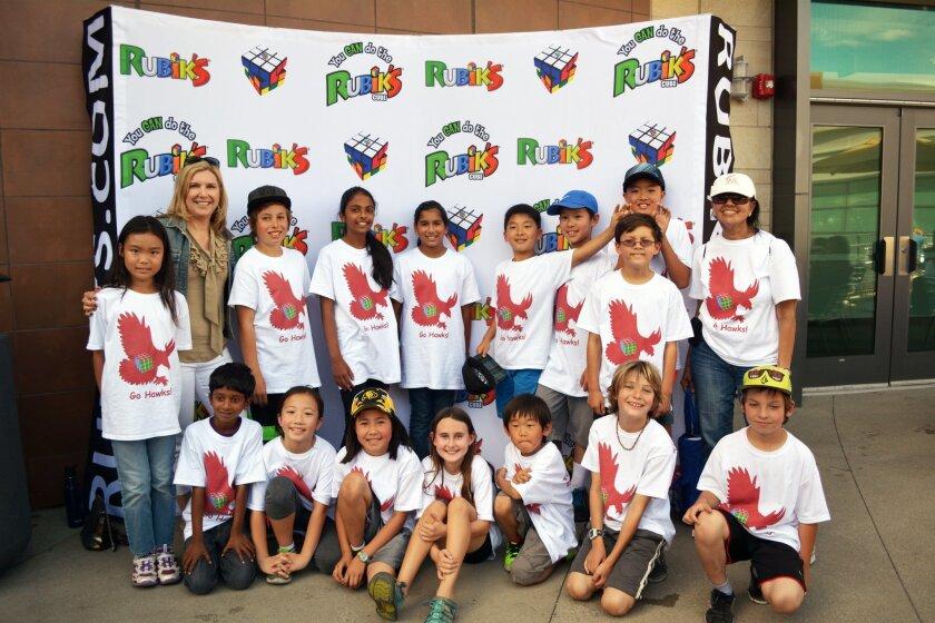 Pictured: Principal Mrs. Sorenson and teacher Mrs. Krishnan with the Torrey Hills Rubik's Team.