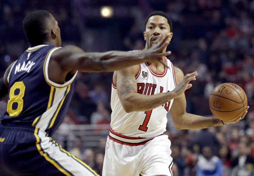 low cost 575e0 33a68 Derrick Rose scores 22 to lead Bulls to 92-85 win over Jazz ...