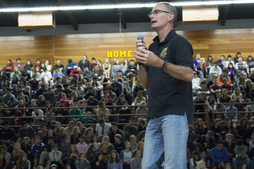 DEA agent Rocky Herron addressing Torrey Pines students.
