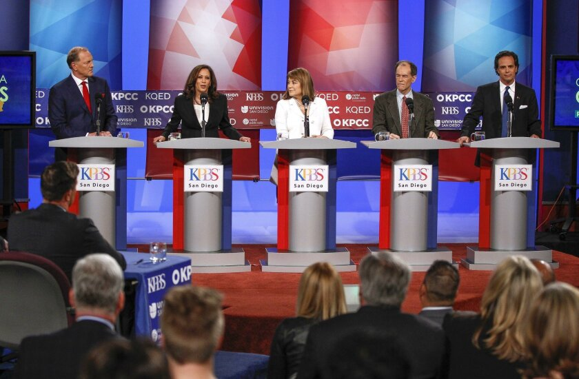 The top five candidates running to replace retiring U.S. Sen. Barbara Boxer, from left, Duf Sundheim, Kamala Harris, Loretta Sanchez, Ron Unz, and Tom Del Beccaro, stand on stage during a debate on live television, radio, and internet at KPBS in San Diego on Tuesday.