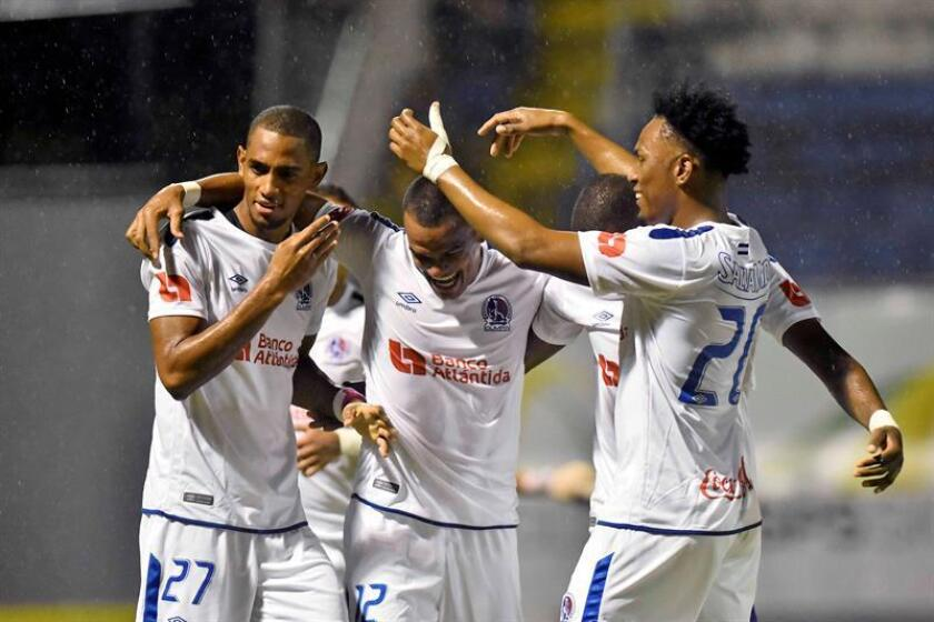 Olimpia players celebrqate a goal against Real España, on Oct. 27, 2018, at the Francisco Morazan stadium in the city of San Pedro Sula (Honduras). EPA-EFE FILE/José Valle