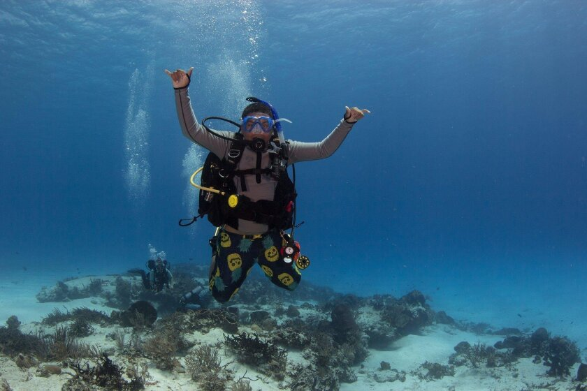 Tennessee Cumming, 12, of Rancho Santa Fe, shown diving off Palau, has become the world's youngest Junior Master Scuba Diver.
