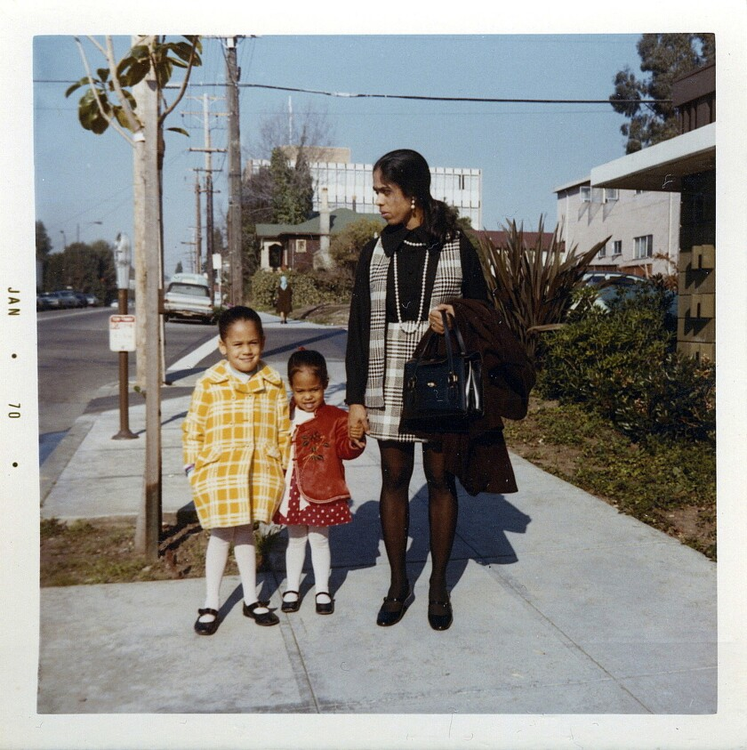 This January 1970 photo shows her, left, with her sister, Maya, and mother, Shyamala, outside their apartment in Berkeley.