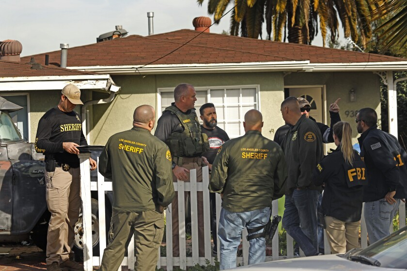 Sheriff deputies search the home of a suspect Paul Flores in the case of missing student Kristin Smart