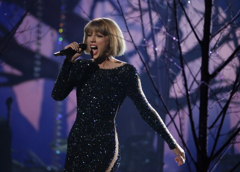 """Singer and songwriter Taylor Swift, shown during her performance for the 2016 Grammy Awards, has demonstrated numerous smart career moves during the 10 years since the release of her debut album, """"Taylor Swift,"""" in 2006."""