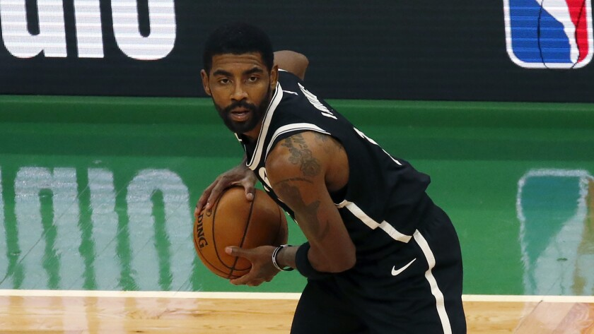 Brooklyn Nets guard Kyrie Irving handles the ball during a game.