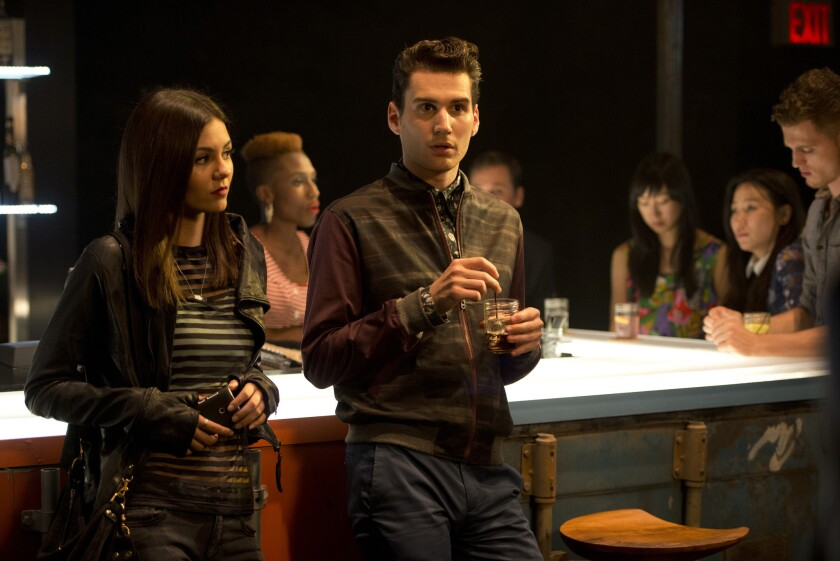 """""""Eye Candy's"""" Victoria Justice, shown with John Garet Stoker, plays a tech whiz who fights crime."""