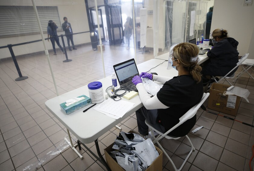 Medical assistant Marianne Orantes prepares to see people being tested for COVID-19 at the Mexican Consulate in Los Angeles.