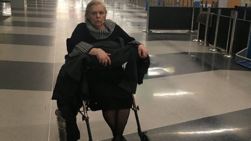 A family photo shows Olimpia Warsaw on Dec. 1, 2018, at O'Hare International Airport. Her son, Claude Coltea, says his mother has Parkinson's disease and diabetes and has trouble communicating. Coltea says a porter left when his shift ended, leaving Warsaw alone at the airport.