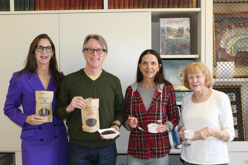 Coffee and Conversations sponsor Deana Ingalls of Carter Financial with Caffe Positano owner Tim Cusac and RSF Library Guild members Jill Stiker and Nancy Miller.