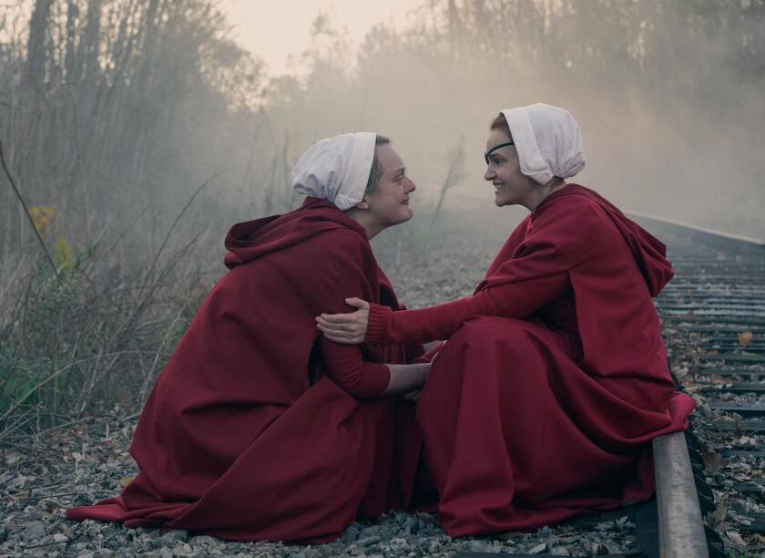 """June (Elisabeth Moss) and Janine (Madeline Brewer) make their escape in """"The Handmaid's Tale."""""""