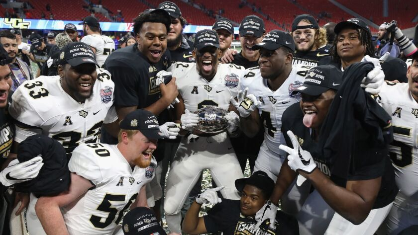 Central Florida players celebrate after defeating Auburn 34-27 in the Peach Bowl on Jan. 1.