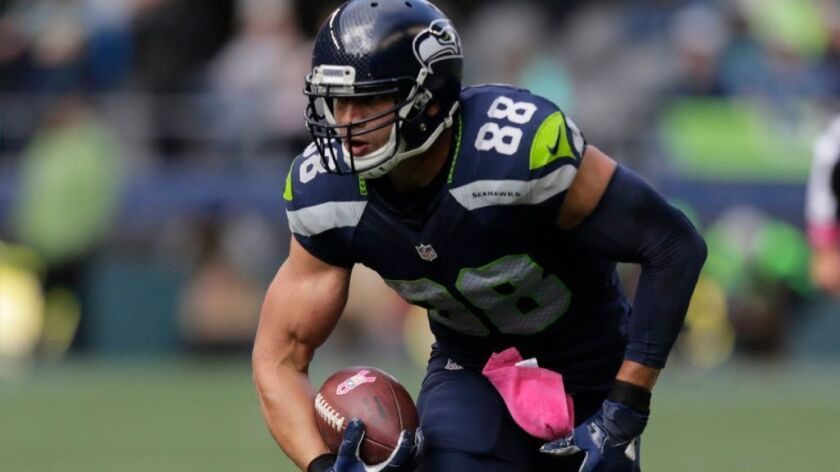 Seahawks tight end Jimmy Graham runs with the ball after making a catch against the Falcons during a game on Oct. 16.