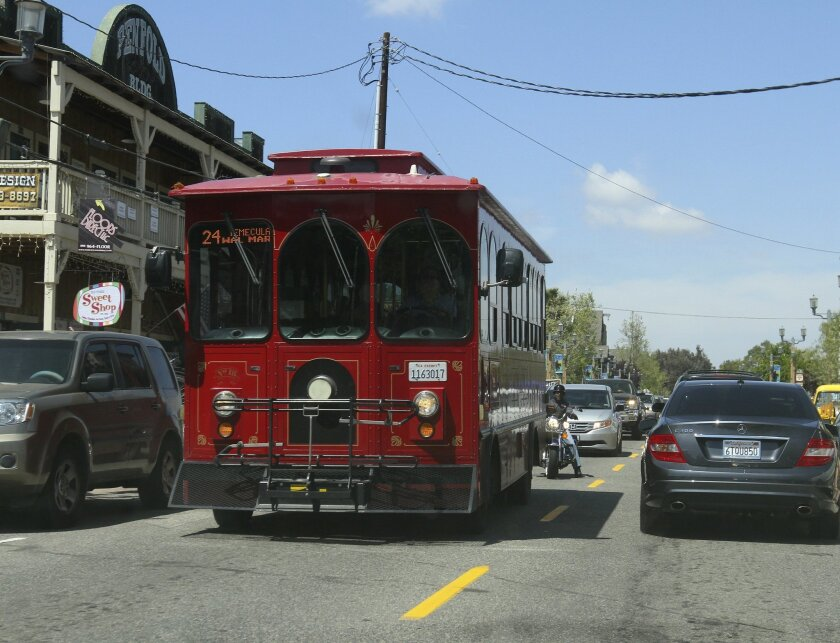 A trolley drives down Old Town Front Street on a recent Saturday. Old Town merchants are preparing to kick off a pilot program that would offer trolley service throughout the historic district each Saturday.