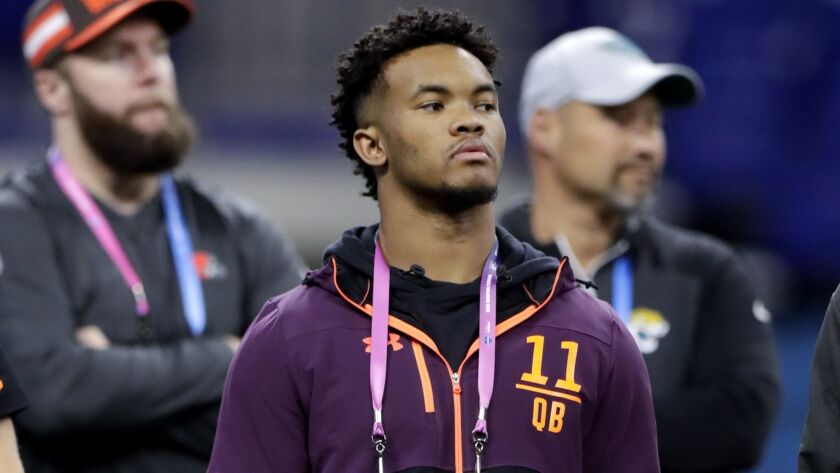 Oklahoma quarterback Kyler Murray watches a drill at the NFL scouting combine on Saturday.