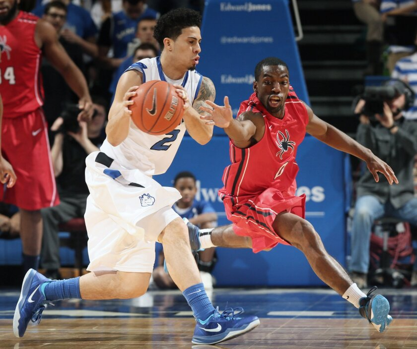 Richmond guard Kendall Anthony, right, tries unsuccessfully to force a turnover by Saint Louis University guard Austin McBroom during the first half of an NCAA basketball game, Wednesday, Jan. 29, 2014 in St. Louis. (AP Photo/St. Louis Post-Dispatch, Chris Lee)  EDWARDSVILLE INTELLIGENCER OUT; THE