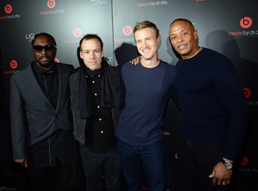 Recording artist will.i.am, Beats Electronics President Luke Wood, Beats Music CEO Ian Rogers and Beats Electronics Founder Dr. Dre arrive at a Beats by Dr. Dre Consumer Electronics Show after-party at the Light Nightclub at the Mandalay Bay Resort and Casino in Las Vegas.