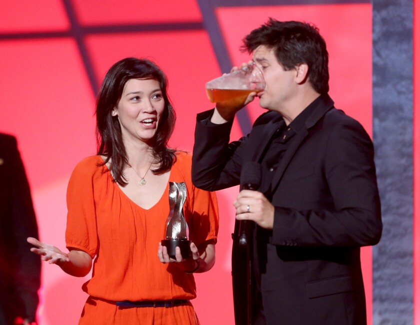 Erica Oyama and Ken Marino, accepting an award for online comedy series, have been signed to adapt a certain not-safe-for childrens' book for the big screen.