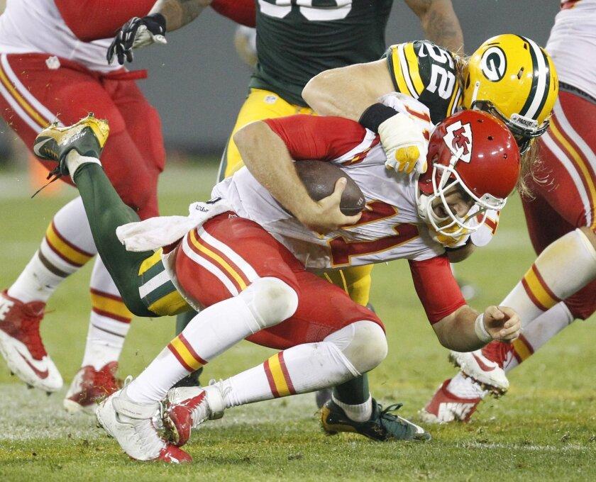 Green Bay Packers' Clay Matthews sacks Kansas City Chiefs' Alex Smith during the second half of an NFL football game Monday, Sept. 28, 2015, in Green Bay, Wis. (AP Photo/Matt Ludtke)