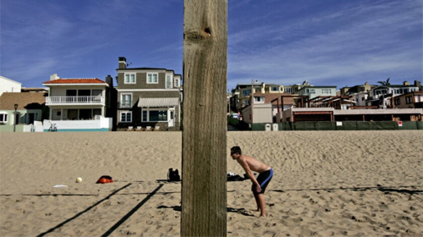 BIG CHANGE: A 16,000-square-foot home, above the sand at right, is going up on the Strand.