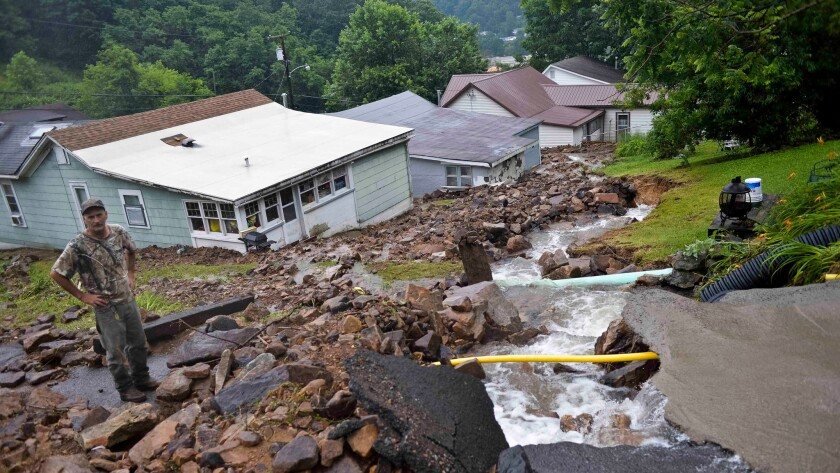Rob Morissin stands among the aftermath of a rockslide caused by severe flooding that poured into his property in Richwood, W.Va. on June 24.