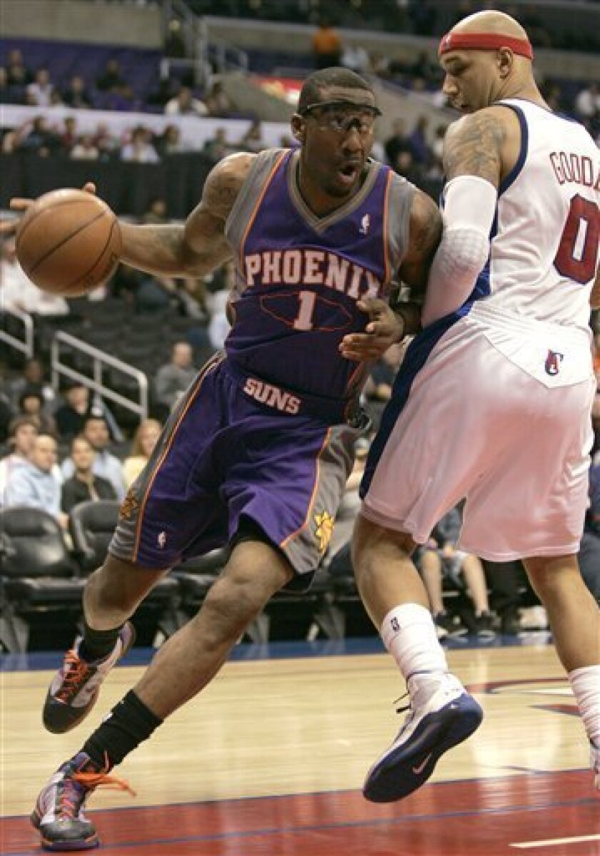 Phoenix Suns forward Amare Stoudemire (1) drives to the basket while defended by Los Angeles Clippers forward Drew Gooden (0) in the first half of an NBA basketball game in Los Angeles, Wednesday, March 3, 2010. (AP Photo/Jason Redmond)