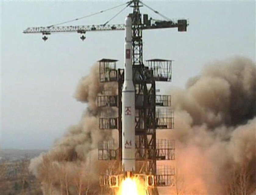 """FILE - In this April 5, 2009 image made from KRT video, a rocket is lifted off from its launch pad in Musudan-ri, North Korea. As international tensions rise over a planned North Korean rocket launch, the U.N. nuclear agency is taking a wait and see attitude on an offer from the North to allow agency experts back into the country, according to a letter shared Tuesday, April 3, 2012 with The Associated Press. In the March 30 letter, circulated internally among the International Atomic Energy Agency's 35 member nations, IAEA head Yukiya Amano expresses thanks for the March 16 overture by North Korean Atomic Energy head Ri Je Son and says """"the IAEA will follow up on your invitation in a constructive spirit."""" (AP Photo/KRT via AP Video, File) NORTH KOREA OUT, TV OUT"""