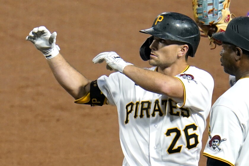 Pittsburgh Pirates' Adam Frazier celebrates after driving in two runs with a single off New York Mets starting pitcher Marcus Stroman during the second inning of a baseball game in Pittsburgh, Friday, July 16, 2021. (AP Photo/Gene J. Puskar)