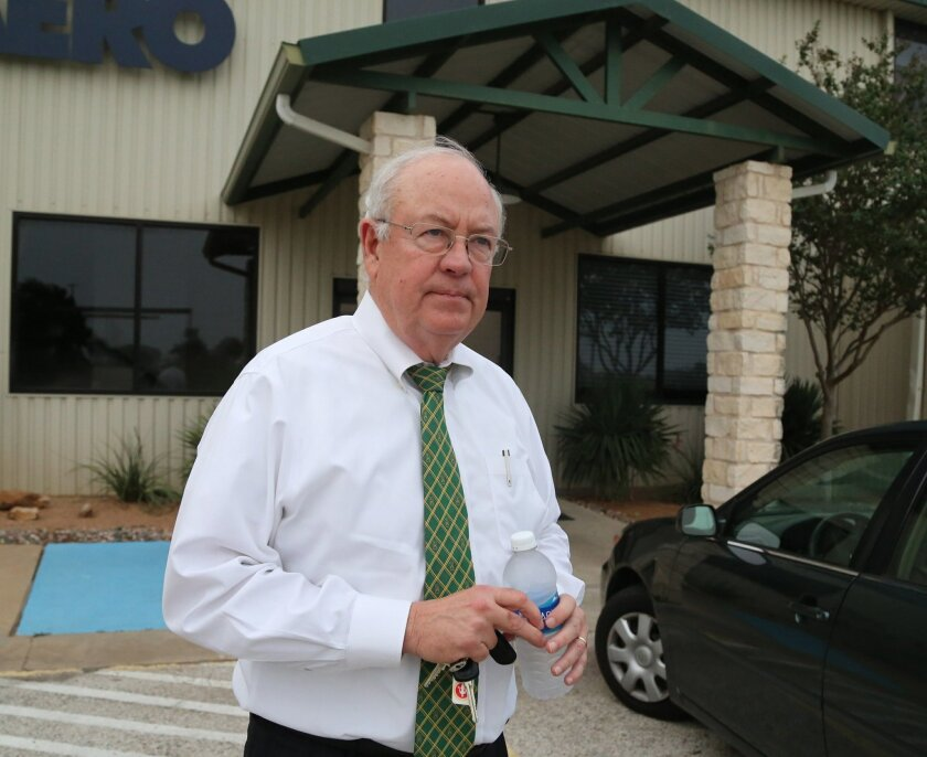 In this photo taken Wednesday, May, 25, 2016, Baylor President Ken Starr leaves a terminal at  Waco airport in Waco, Texas.  Baylor University's board of regents says it will fire football coach Art Briles and re-assign Starr in response to questions about its handling of sexual assault complaints