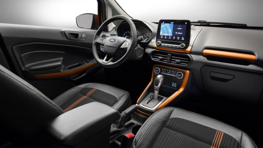 Ford EcoSport SES features unique interior styling cues such as bold copper accents on the instrumen