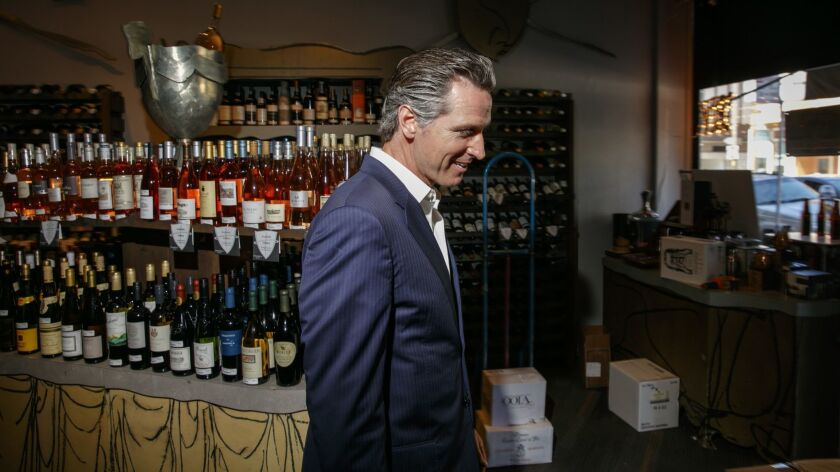 Gavin Newsom visits PlumpJack Wines and Spirits, a store he opened in 1992 in the Marina District of San Francisco.