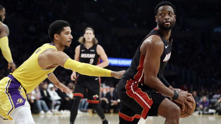 Miami Heat's Dwyane Wade, right, is defended by Los Angeles Lakers' Josh Hart during the second half