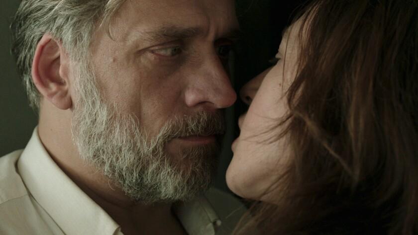 "Lior Ashkenazi and Sarah Adler in the film ""Foxtrot."""
