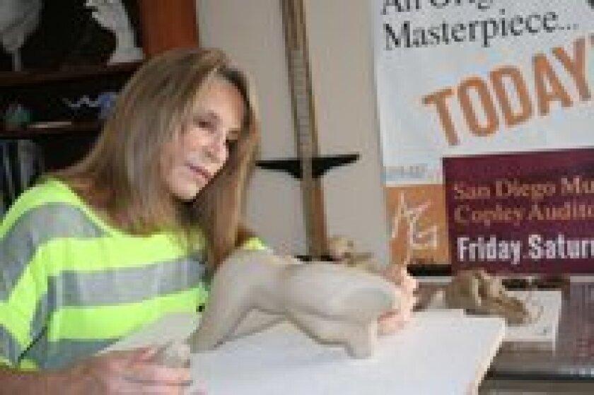 Local sculptor Maidy Morhous works in her studio.  Photo: Karen Billing