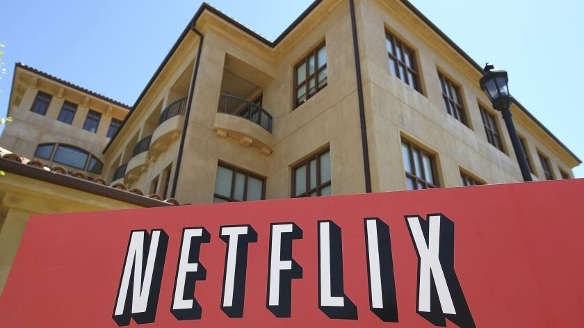 A sign is posted in front of the Netflix headquarters in July 2011 in Los Gatos, Calif.