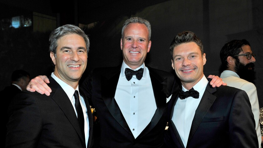 LACMA director Michael Govan, left; Andy Brandon-Gordon, a partner at Goldman Sachs and museum board co-chair; and Ryan Seacrest, a TV personality and recently minted museum board trustee, attend the 2014 LACMA Art + Film Gala.