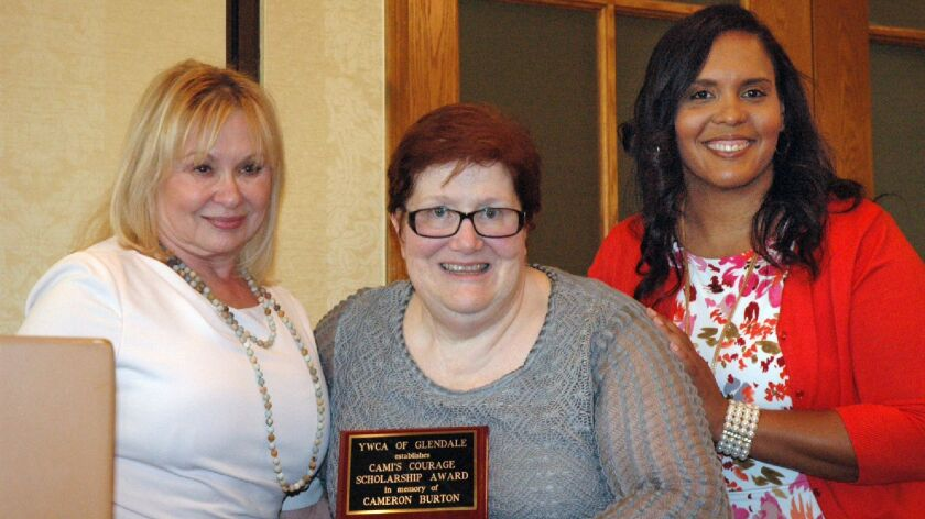 Carol Ann Burton, center, with Legacy Event Chair Suzonne Slaughter, left, and YWCA Executive Direct