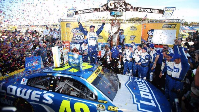 Nascar driving Jimmie Johnson celebrates after his victory at Martinsville Speedway on Oct. 30.