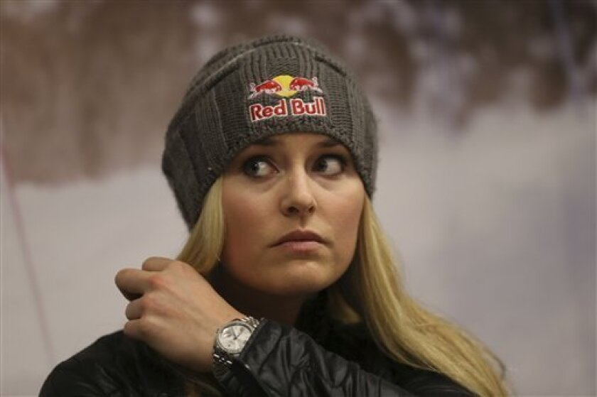 U.S. ski racer Lindsey Vonn gestures during a press conference in view of the World Cup Alpine Skiing, in Schladming, Austria, Sunday, Feb. 3, 2013. With media attention on her personal life intensifying and some 400,000 fans expected, Lindsey Vonn will be surrounded by bodyguards at the Alpine ski