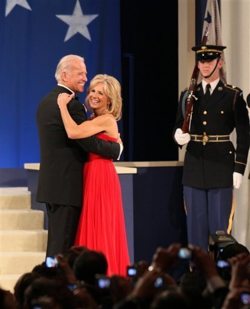 """Vice President Joe Biden and his wife Jill Biden dance at the """"Biden Home States Ball"""", one of many inaugural balls at the Washington Convention Center in the nation's capital, Tuesday, Jan. 20, 2009. (AP Photo/J. Scott Applewhite)"""