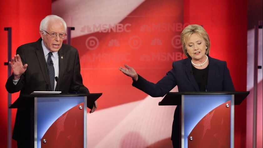 Sen. Bernie Sanders and Hillary Clinton spar during a Democratic presidential primary debate hosted by MSNBC at the University of New Hampshire in Durham, N.H., on Feb. 4, 2016.