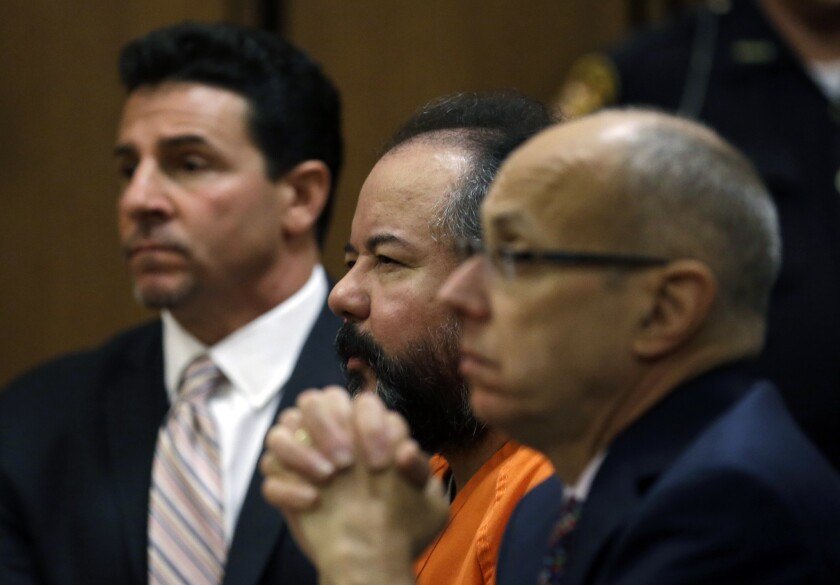 Ariel Castro, center, looks up during court proceedings on Wednesday in Cleveland. Flanking him are defense attorney Craig Weintraub, left, and Jaye Schlachet.