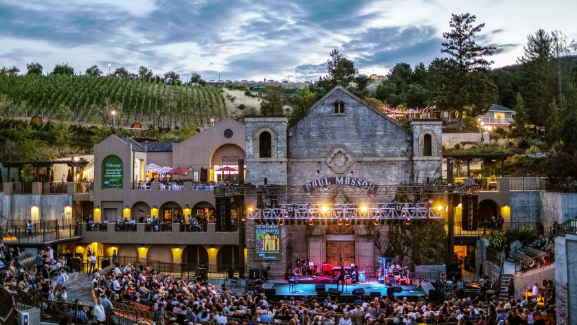 SARATOGA, CA - Concert attendees savor live music in a stunning outdoor setting at the Mountain Wine