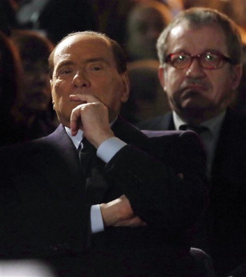 """Former Italian Premier Silvio Berlusconi, foreground, sits in front of Northern League party's leader Roberto Maroni, in Milan, Italy, Sunday, Jan. 27, 2013. Silvio Berlusconi says Benito Mussolini did much good, except for dictator's regime's anti-Jewish laws. Berlusconi also defended Mussolini for siding with Hitler, saying the late fascist leader likely reasoned that German power would expand so it would be better for Italy to ally itself with Germany. He was speaking to reporters Sunday on the sidelines of a ceremony in Milan to commemorate the Holocaust. When Germany's Nazi regime occupied Italy during World War II, thousands from the tiny Italian Jewish community were deported to death camps. In 1938, before the war's outbreak, Mussolini's regime passed anti-Jewish laws, barring them from universities and many professions, among other bans. Berlusconi called the laws Mussolini's """"worst fault"""" but insisted that in many other things, """"he did good."""" (AP Photo/Antonio Calanni)"""