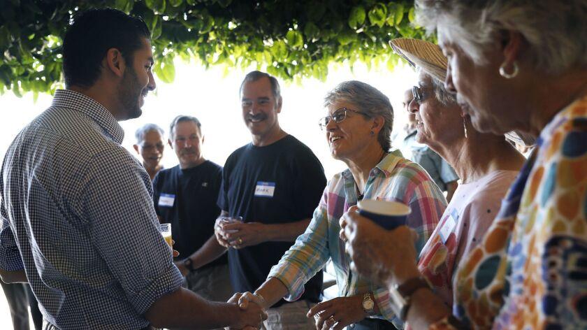 ESCONDIDO-CA-SEPTEMBER 9, 2018: Ammar Campa-Najjar, left, arrives at a Meet and Greet in Escondido o