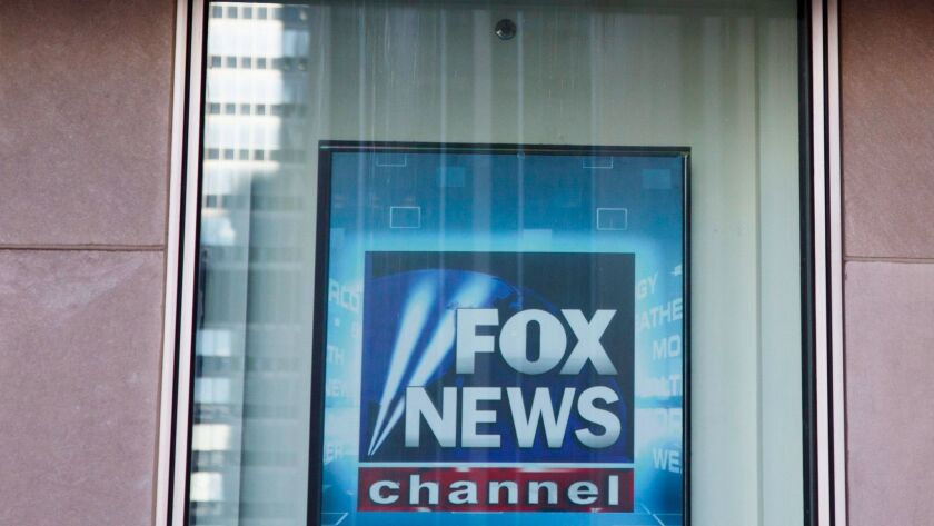epa05642804 A news ticker passes over a sign on the Fox News studios in New York, New York, USA, on