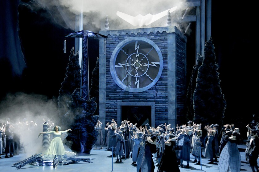 """Camilla Nylund (Elsa von Brabant) and the choir in """"Lohengrin."""" Yuval Sharon has revived his production at the Bayreuth Festival."""