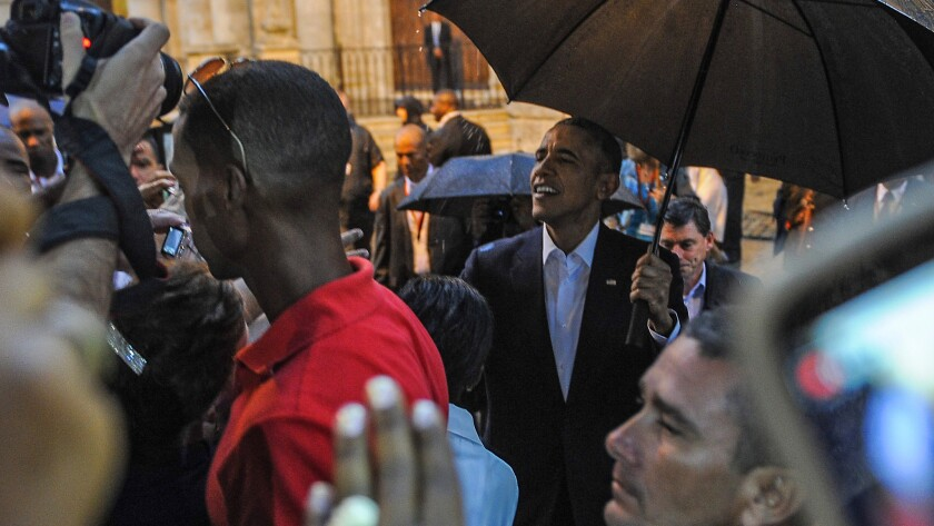 President Obama talks to tourists and Cubans on his arrival at the Havana Cathedral on Sunday.